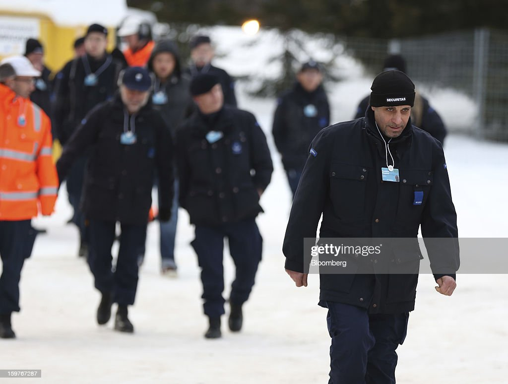 Security officers arrive at an entrance to the Congress Centre ahead of the World Economic Forum (WEF) meeting in Davos, Switzerland, on Sunday, Jan. 20, 2013. Next week the business elite gathers in the Swiss Alps for the 43rd annual meeting of the World Economic Forum in Davos, the five day event that will run from Jan. 23-27. Photographer: Jason Alden/Bloomberg via Getty Images