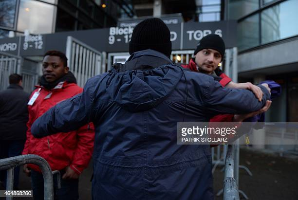 Security officers check supporters arriving at the stadium prior to the German first division Bundesliga football match SV Werder Bremen vs VfL...