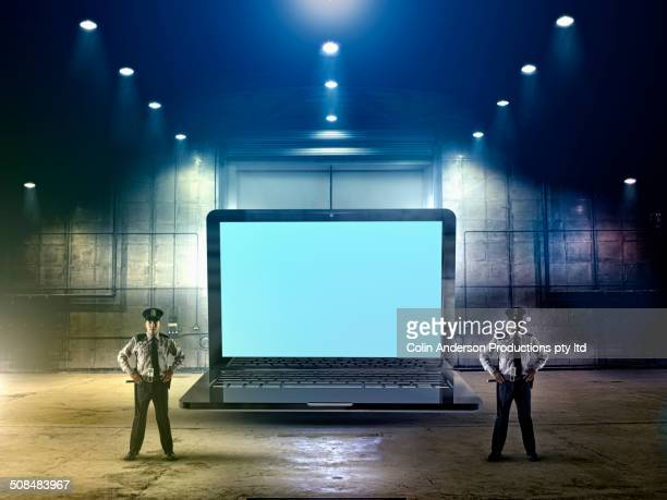 Security officers guarding laptop computer