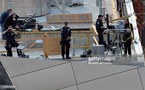 Security officers observe the perimeter from the roof of the 9/11 memorial museum during the ceremony marking the 10th anniversary of the terrorist...