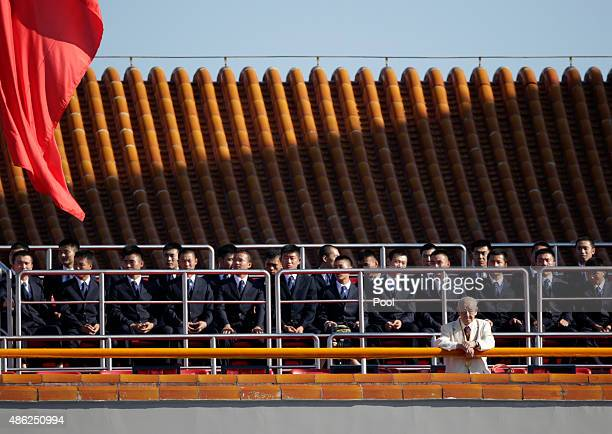 Security officers sit on the Tiananmen Gate ahead of the military parade to mark the 70th Anniversary of the end of World War Two on September 3 2015...