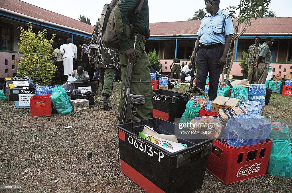 Security officers stand over ballot materials collected by poll-officials from Independent Electoral and Boundaries Commission (IEBC) to go to polling centers on March 3, 2013 in Kakamega, on the eve of the Kenyan presidential, gubernatorial and senatorial elections. AFP PHOTO/Tony KARUMBA