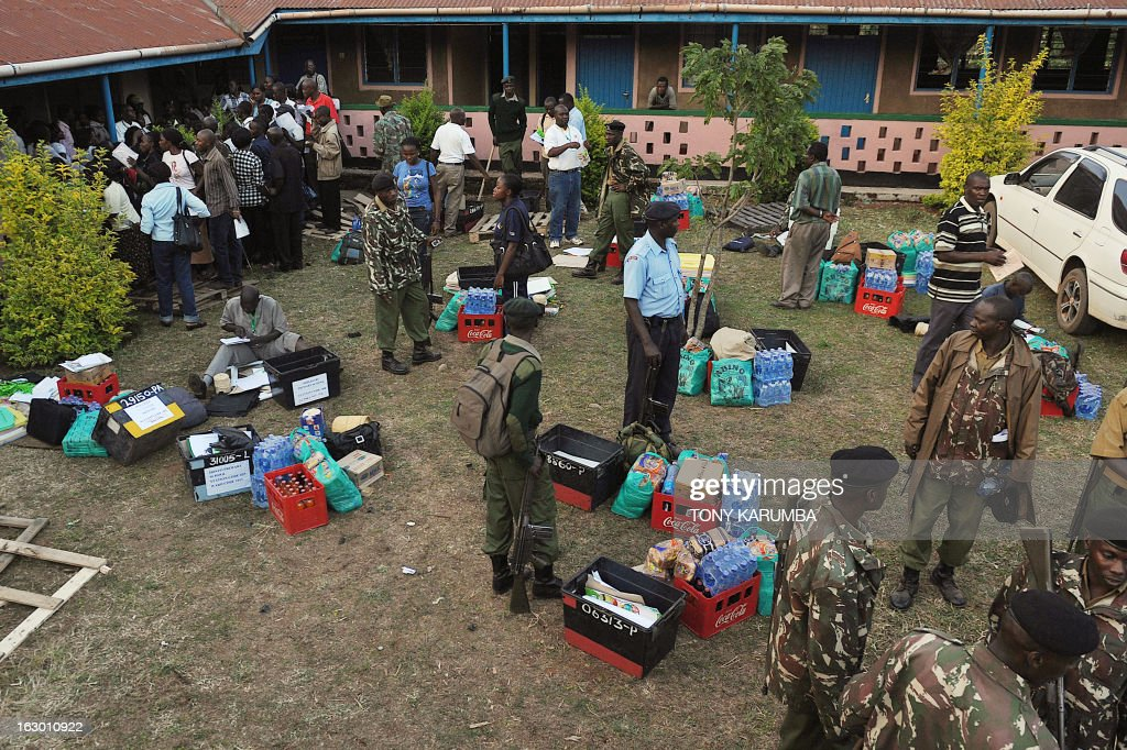 Security officers stand over ballot materials collected by poll-officials to go to vote offices on March 3, 2013 in Kakamega, on the eve of the Kenyan presidential, gubernatorial and senatorial elections. AFP PHOTO/Tony KARUMBA