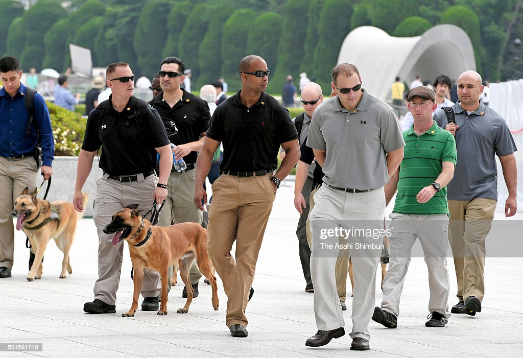 U.S. security officers with sniffer dogs check at the Hiroshima Peace Memorial Park ahead of the U.S. President Barack Obama on May 27, 2016 in Hiroshima, Japan. Obama becomes the first sitting U.S. president to visit Hiroshima, where the first atomic bomb was dropped in 1945 at the end of World War II.