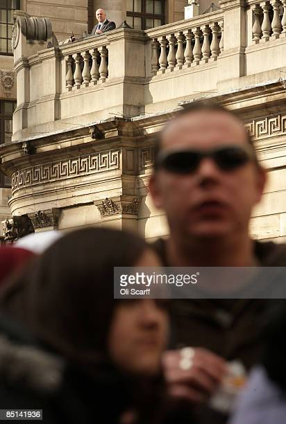 A security official keeps an eye of protesters for 'Stop Huntingdon Animal Cruelty' as they gather in front of the Bank of England on February 27...