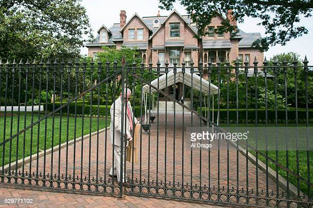 STATES MAY 9 A security official locks the gate after removing a sign on the gate outside of the Governor's Mansion in Raleigh NC on Monday May 9...