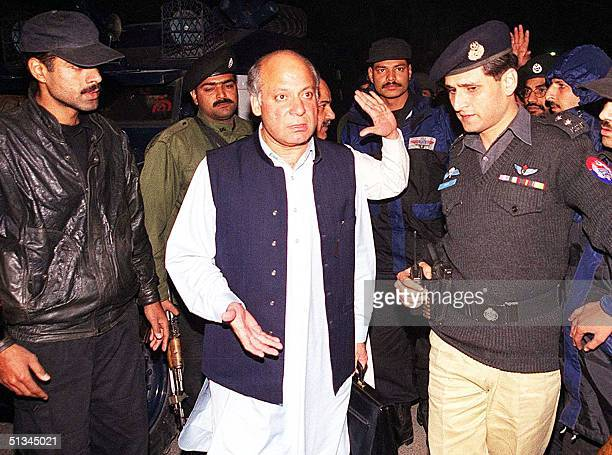 Security officials escort deposed Prime Minister Nawaz Sharif to his residence in the Pakistani city of Lahore 16 Dcember 1999 A Pakistan court...
