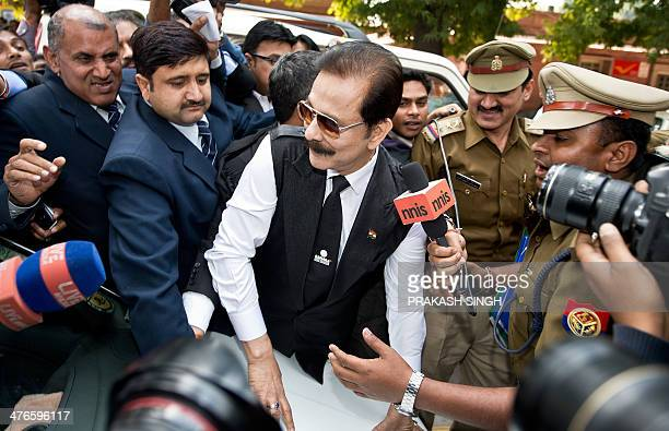 Security officials escort India's Sahara group chairman Subrata Roy on his arrival at the Supreme Court in New Delhi on March 4 2014 Black ink was...