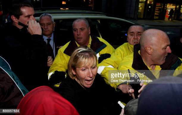 Security outside Manchester Town Hall as cars containing Nick Griffin attempt to drop him off ahead of the results of the European Parliamentary...