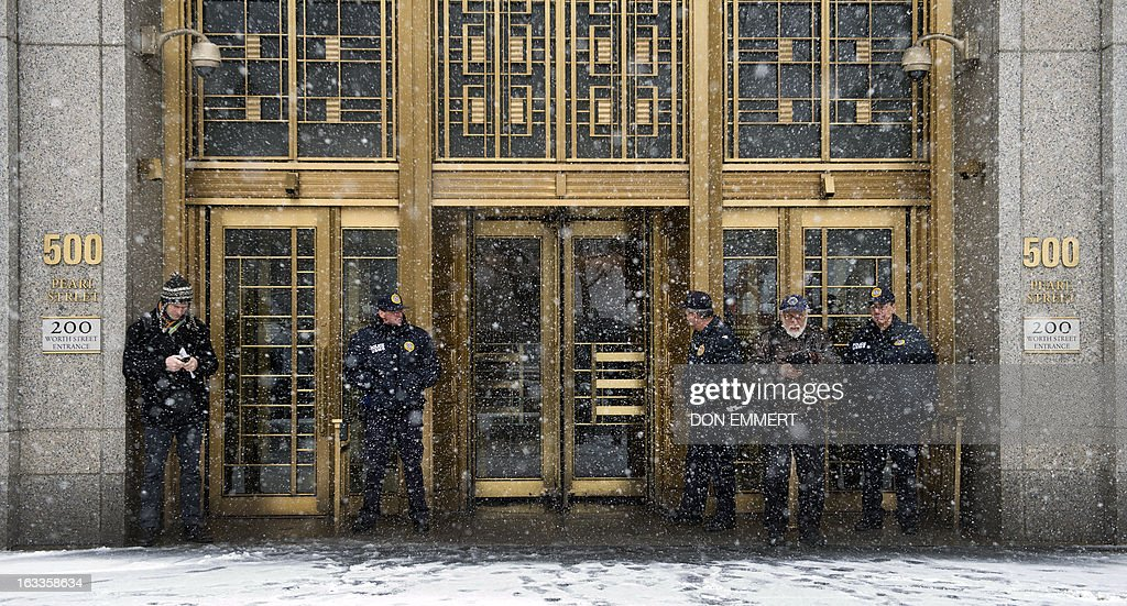 Security outside the Federal Courthouse in Manhattan March 8, 2013 in New York. Inside the court Osama bin Laden's son-in-law and former spokesman pleaded not guilty Friday to terrorism charges in New York, where he was brought a week ago after a top secret US operation. Sulaiman Abu Ghaith, reportedly a 47-year-old Kuwaiti and allegedly a senior propagandist in the Al-Qaeda network, is accused of conspiring 'to kill nationals of the United States.'