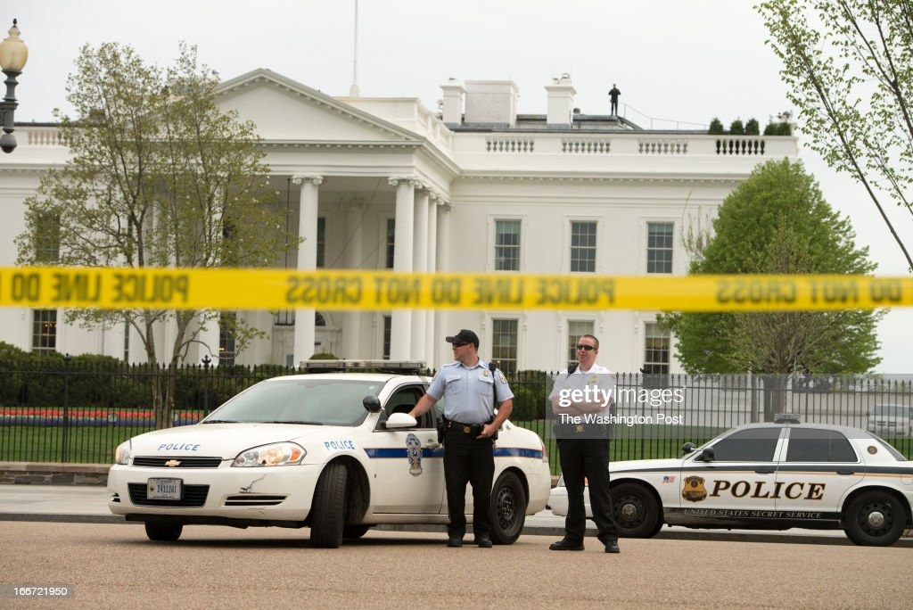 Security outside the White House closed down the Pennsylvania Ave street near Lafayette Park due to a high security alert in Washington, D.C. on April 15, 2013. Yellow tape was put up to prevent tourists from getting close to the White House fence. High security alert in the D.C. Metropolitan Area is raised due to the Boston bomb explosions.