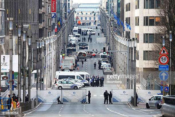A security perimeter fence stands on Wetstraat as police and security forces gather outside Maelbeek metro station following a bomb attack in...
