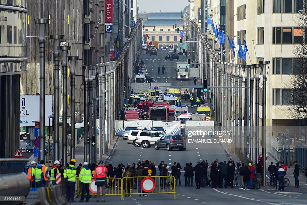 TOPSHOT A security perimeter has been set on March 22 2016 near Maalbeek Maelbeek metro station in Brussels after a blast at this station near the EU...