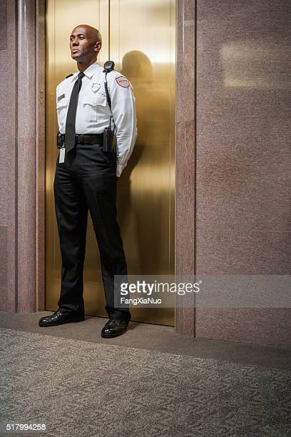 Security peronnel standing guard