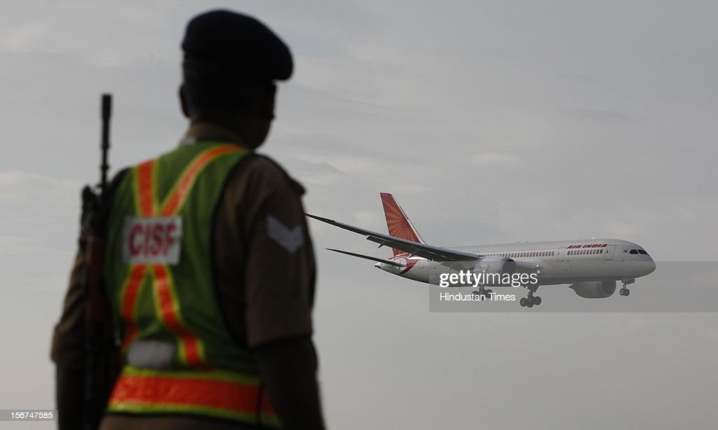 'NEW DELHI, INDIA - SEPTEMBER 8: Security person watch as the new member of Air India advanced Boeing 787 Dreamliner touched down at IGI airport on September 8, 2012 in New Delhi, India. (Photo by Raj k Raj/Hindustan Times via Getty Images)'