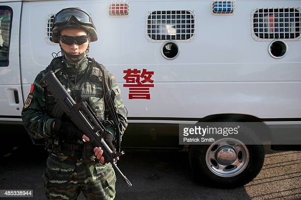 Security personel stand guard outside the Beijing National Stadium during day six of the 15th IAAF World Athletics Championships Beijing 2015 at...