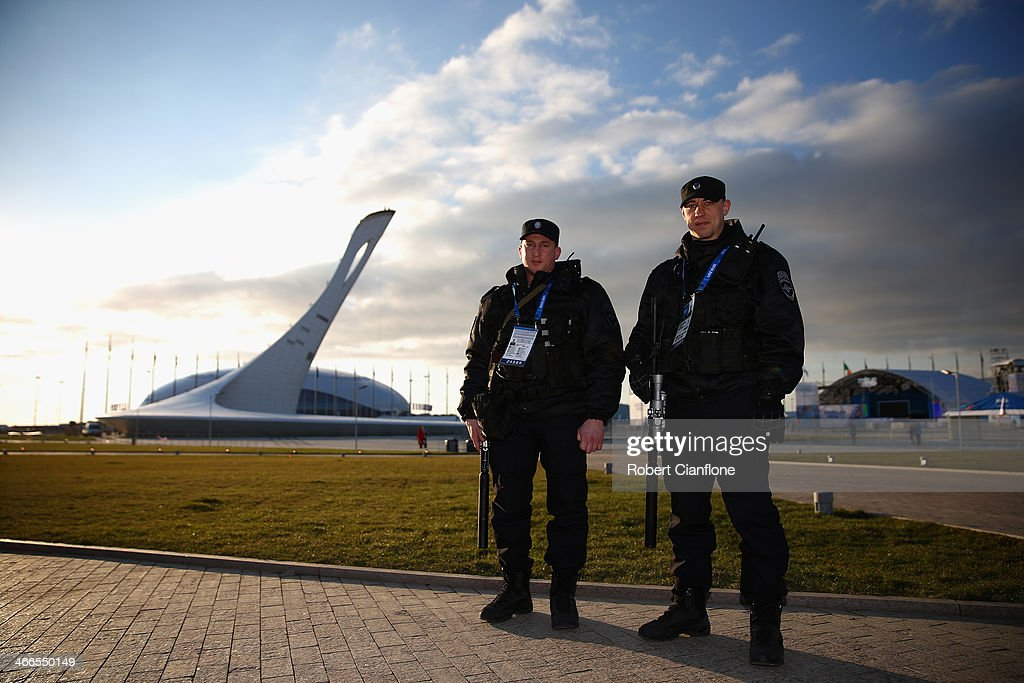 Security personnel are seen in front of the cauldron prior to the Sochi 2014 Winter Olympics, at the Coastal Olympic Village on February 2, 2014 in Sochi, Russia.