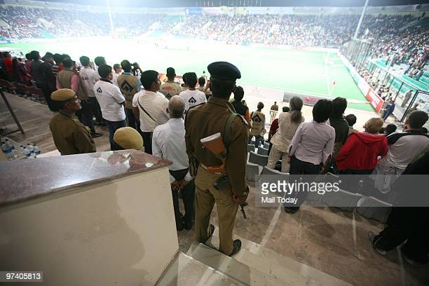 Security personnel can be seen at guard at the Dhyan Chand Nation Hockey Stadium during the pool B match of India against Pakistan at the Hockey...