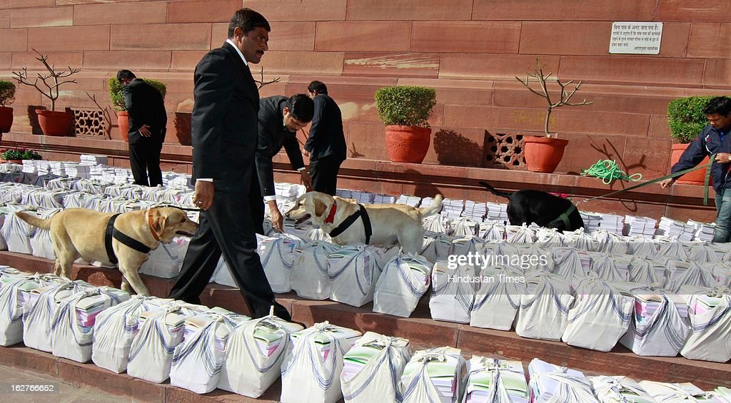 Security personnel checking the budget papers at Parliament as Railway minister present the Indian Railway budget 2013-14, on February 26, 2013 in New Delhi, India.