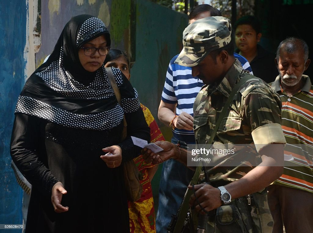Security personnel checking the identity card at a polling station in Kolkata, India on Saturday , 30th April , 2016. The fifth phase of state assembly elections in West Bengal are taking place from April 4 to May 5, 2016.