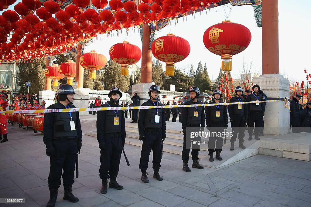 Security personnel guard during the opening ceremony of the Spring Festival Temple Fair at the Temple of Earth park on January 30, 2014 in Beijing, China. The Chinese Lunar New Year of Horse also known as the Spring Festival, which is based on the Lunisolar Chinese calendar, is celebrated from the first day of the first month of the lunar year and ends with Lantern Festival on the Fifteenth day.