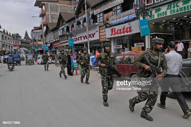 Security personnel launch a cordonandsearch operation in commercial hub of Lal Chowk after reports of presence of militants in the area on June 10...