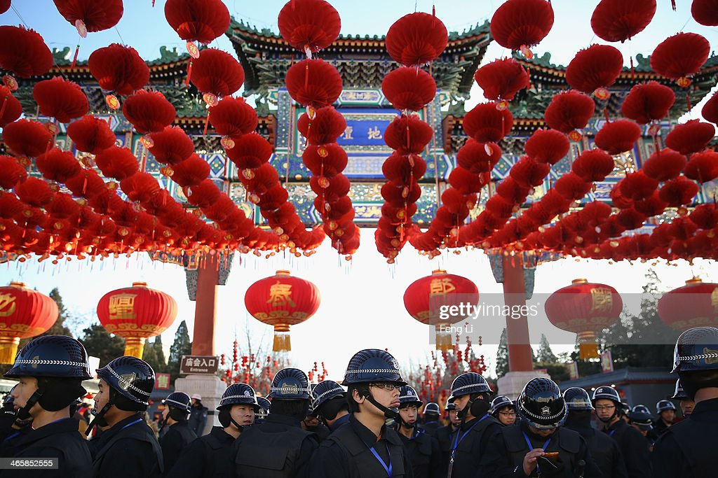 Security personnel line up before the opening ceremony of the Spring Festival Temple Fair at the Temple of Earth park on January 30, 2014 in Beijing, China. The Chinese Lunar New Year of Horse also known as the Spring Festival, which is based on the Lunisolar Chinese calendar, is celebrated from the first day of the first month of the lunar year and ends with Lantern Festival on the Fifteenth day.