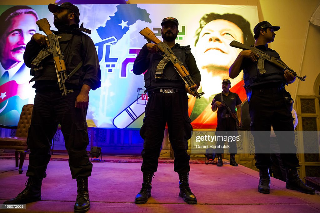Security personnel look on as Imran Khan (unseen), chairman of the Pakistan Tehrik e Insaf (PTI) party, addresses volunteers and supporters during a rally for volunteers on May 05, 2013 in Lahore, Pakistan. Pakistan's parliamentary elections are due to be held on May 11. Imran Khan of Pakistan Tehrik e Insaf (PTI) and Nawaz Sharif of the Pakistan Muslim League-N (PMLN) have been campaigning hard in the last weeks before polling.