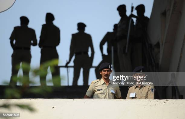 Security personnel lookon as England practice at the Sardar Patel Stadium Ahmedabad India