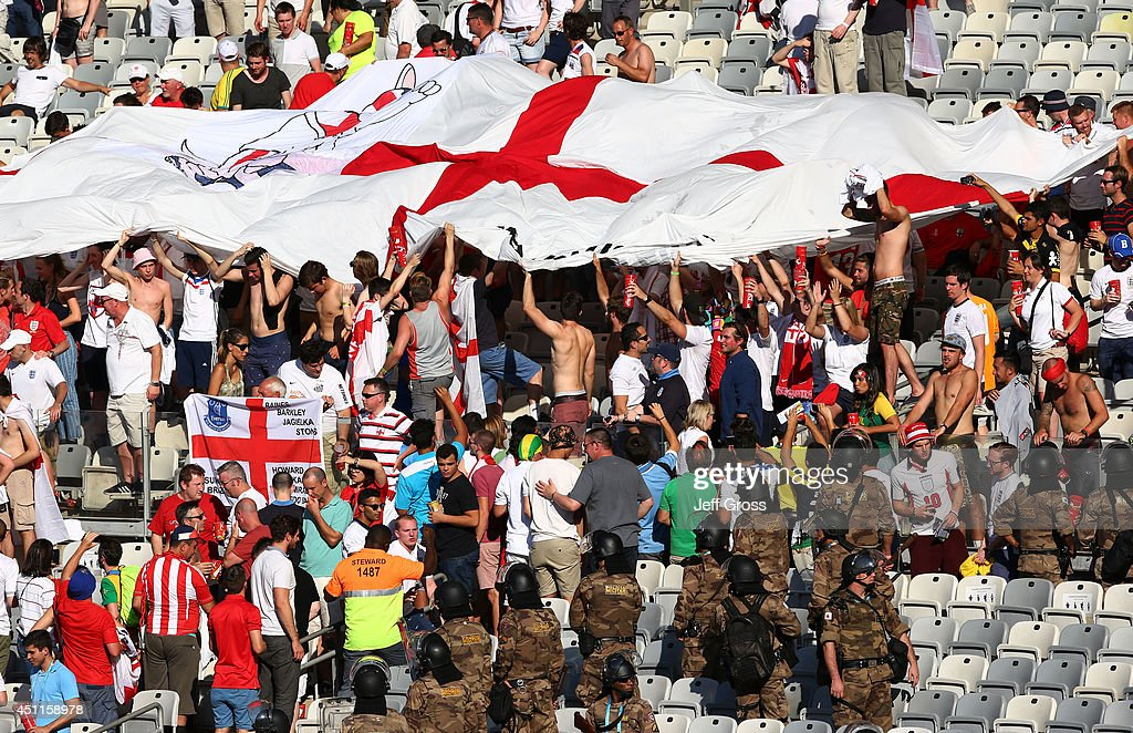 Security personnel move England fans toward the exit during the 2014 FIFA World Cup Brazil Group D match between Costa Rica and England at Estadio Mineirao on June 24, 2014 in Belo Horizonte, Brazil.