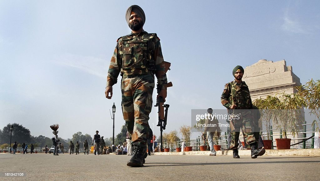 Security personnel on duty as security was tightened at India Gate after the Afzal Guru was hanged, on February 10, 2013 in New Delhi, India. Guru, who was found guilty of conspiring and sheltering the militants who attacked Parliament on December 13, 2001 in which nine people were killed, was buried in the prison premises as per the jail manual.