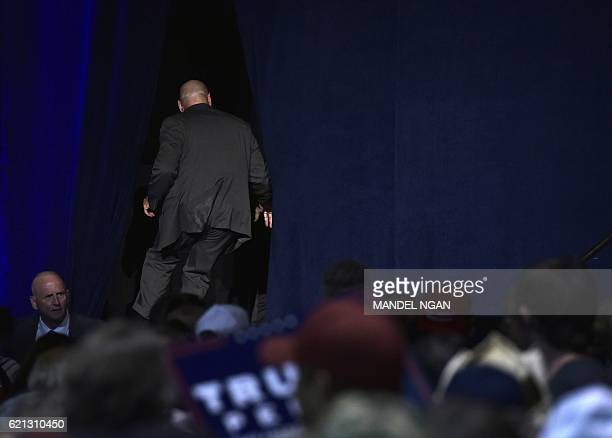 Security personnel rush off stage after Republican presidential nominee Donald Trump was escorted away during a rally at the RenoSparks Convention...