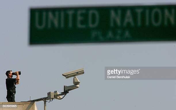 Security personnel scan city streets and buildings from the top of the United Nations buildings September 13 2005 in New York Security is on high...