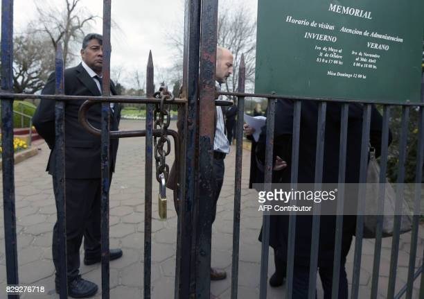 Security personnel stand at the gate of the Memorial park on August 10 2017 in Pilar Buenos Aires outskirts where Jorge Zorreguieta father of Queen...