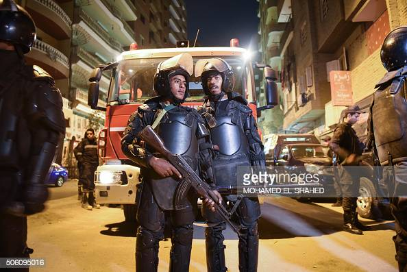 Security personnel stand guard at the scene of a bomb blast in a main street in Giza Egypt January 21 2016 A bomb attack killed six people including...