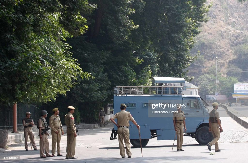 Security personnel stand guard during a strike on June 25, 2013 in Srinagar, India. Shops, businesses and schools were closed in the Kashmir valley after separatist groups called for a strike to protest a visit by the Indian prime minister.