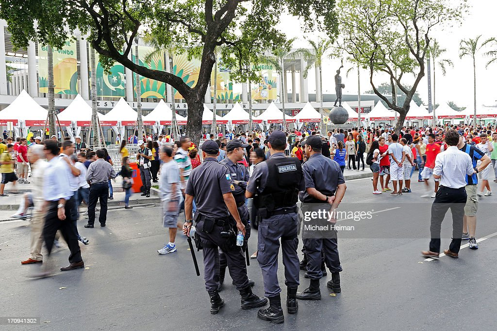 Security personnel stand guard outside of the Maracana prior to the FIFA Confederations Cup Brazil 2013 Group B match between Spain and Tahiti on June 20, 2013 in Rio de Janeiro, Brazil.