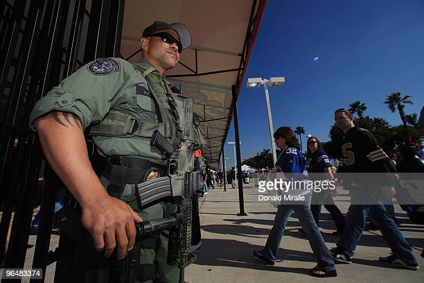 Security personnel stand guard prior to Super Bowl XLIV between the Indianapolis Colts and the New Orleans Saints on February 7 2010 at Sun Life...