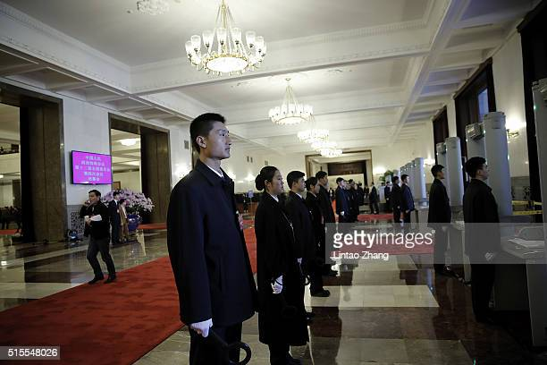 Security personnel stand inside the Great Hall of the People before the Closing Ceremony of the Chinese People's Political Consultative Conference on...