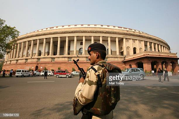 A security personnel stands guard at Parliament House in New Delhi on Friday on the day of presentation of Railways Budget 201112