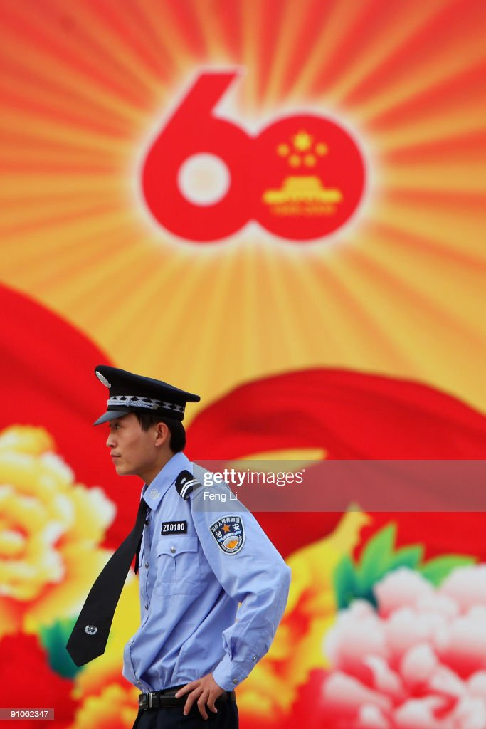 A security personnel stands guard in the People's Republic Of China 60th Anniversary Exhibition at the Beijing Exhibition Center on September 23, 2009 in Beijing, China. The grand celebrations to commemorate the 60th anniversary of the founding of the People's Republic of China are set to include a military parade and mass pageant consisting of about 200,000 citizens in Tian'anmen Square on October 1.