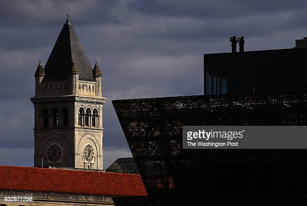 Security personnel survey the rally crowd from the roof of the National Museum of African American History and Culture That's the tower of the Trump...