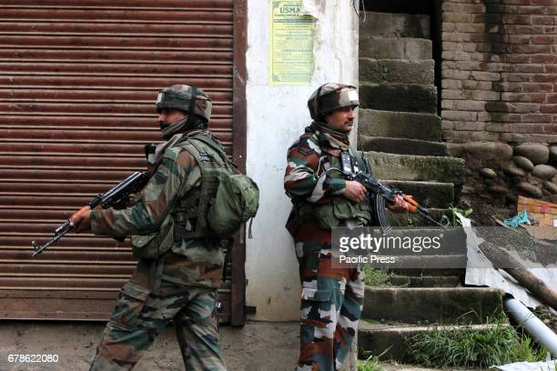 TURKIWANGAM SHOPIAN JAMMU KASHMIR INDIA Security personnel Taking position during a cordon and search operation in Shopian Kashmir on Thursday to...