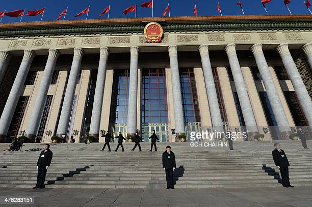 Security personnel walk on the square before the closing ceremony of the Chinese National People's Congress at the Great Hall of the People in...