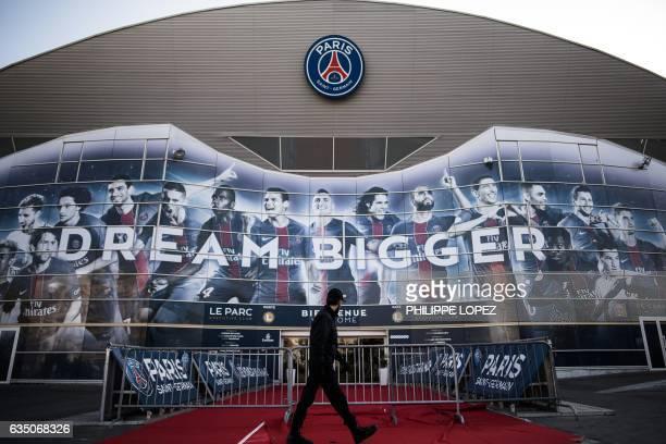 A security personnel walks past Paris SaintGermain's Parc des Princes stadium in Paris on February 13 2017 on the eve of the club's champions league...