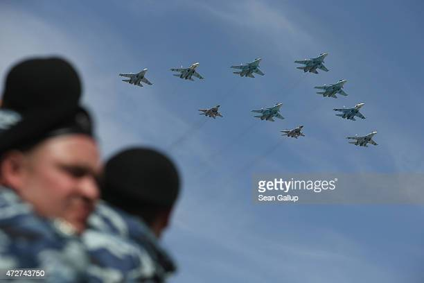 Security personnel watch as Russian air force fighter jets fly towards Red Square in the annual Victory Parade as part of celebrations marking the...