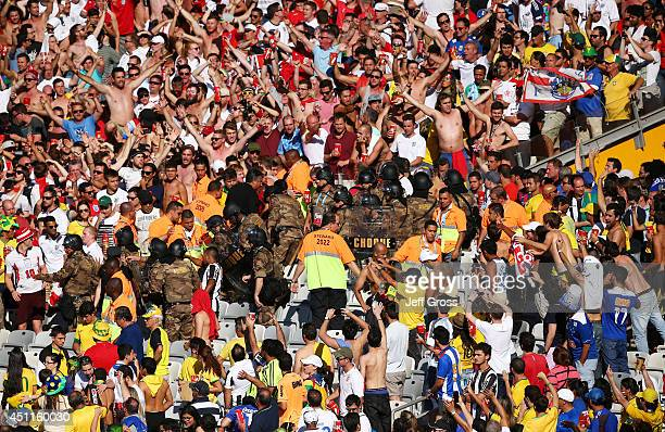 Security perssonel occupy the stands as fans cheer during the 2014 FIFA World Cup Brazil Group D match between Costa Rica and England at Estadio...