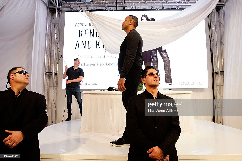 Security reacts after objects were thrown onto the stage just moments before Kendall Jenner and Kylie Jenner were to appear at Westfield Parramatta on November 17, 2015 in Sydney, Australia.