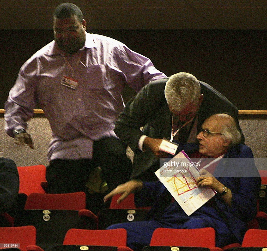 Security remove 82-year-old Walter Wolfgang after he heckled Britain's Foreign Secretary Jack Straw as Straw delivered his key note speech during the annual Labour Party Conference on September 28, 2005 in Brighton, England. The governing Labour Party will be holding it's yearly conference at the English coastal resort until 29 September, 2005. (Photo by Scott Barbour/Getty