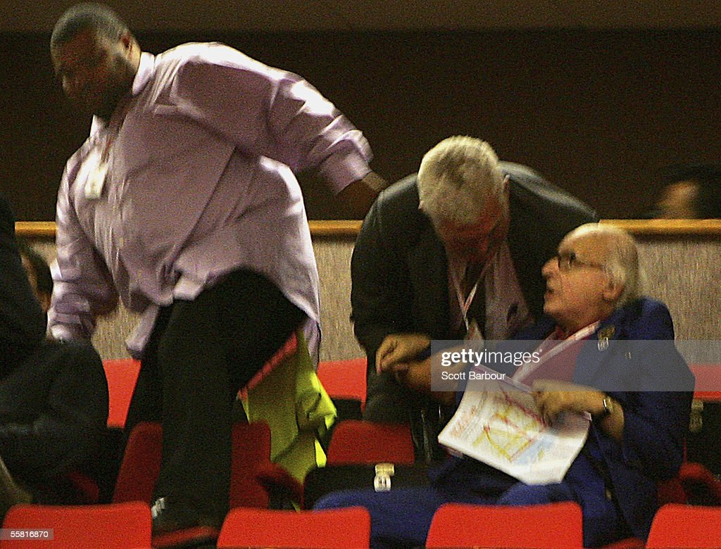 Security remove 82-year-old Walter Wolfgang after he heckled Britain's Foreign Secretary Jack Straw as Straw delivered his key note speech during the annual Labour Party Conference on September 28, 2005 in Brighton, England. The governing Labour Party will be holding its yearly conference at the English coastal resort until 29 September, 2005. (Photo by Scott Barbour/Getty